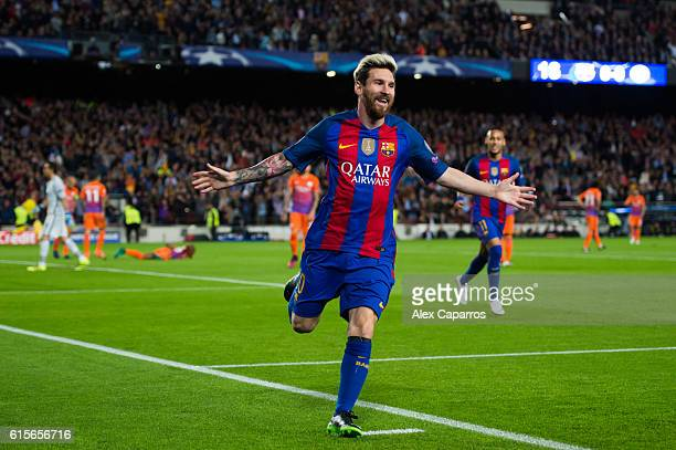 Lionel Messi of FC Barcelona celebrates after scoring the opening goal during the UEFA Champions League group C match between FC Barcelona and...
