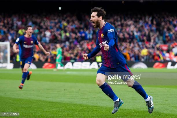 Lionel Messi of FC Barcelona celebrates after scoring the opening goal during the La Liga match between Barcelona and Atletico Madrid at Camp Nou on...