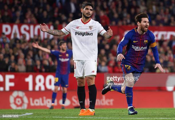 Lionel Messi of FC Barcelona celebrates after scoring the second goal of FC Barcelona during the La Liga match between Sevilla CF and FC Barcelona at...