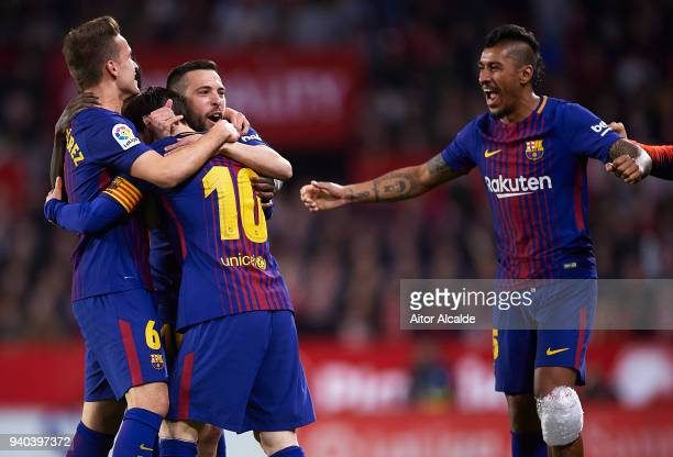 Lionel Messi of FC Barcelona celebrates after scoring the second goal of FC Barcelona with his team mates Denis Suarez of FC Barcelona and Jordi Alba...