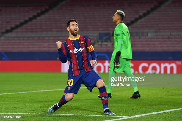 Lionel Messi of FC Barcelona celebrates after scoring their side's first goal during the UEFA Champions League Round of 16 match between FC Barcelona...