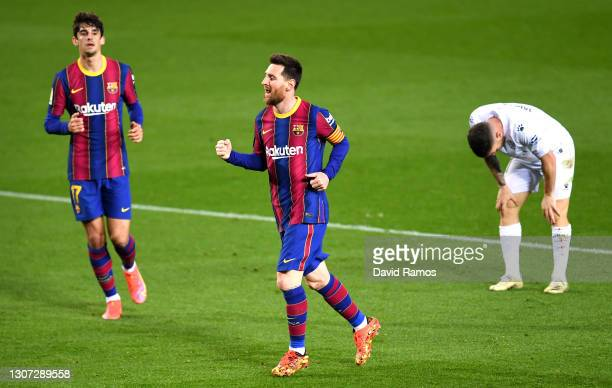 Lionel Messi of FC Barcelona celebrates after scoring their side's fourth goal during the La Liga Santander match between FC Barcelona and SD Huesca...