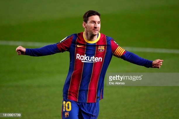 Lionel Messi of FC Barcelona celebrates after scoring their sides first goal during the La Liga Santander match between FC Barcelona and Getafe CF at...