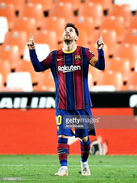 Lionel Messi of FC Barcelona celebrates after scoring their side's third goal during the La Liga Santander match between Valencia CF and FC Barcelona...