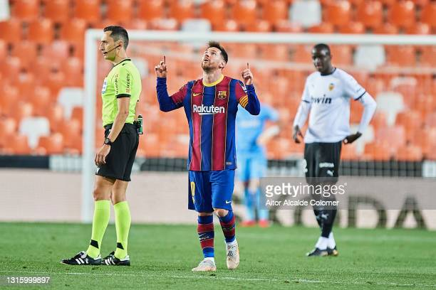 Lionel Messi of FC Barcelona celebrates after scoring their side's third goal during during the La Liga Santander match between Valencia CF and FC...