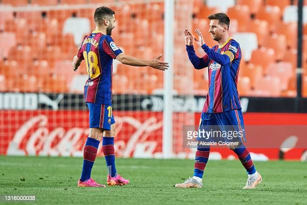 Lionel Messi of FC Barcelona celebrates after scoring their side's third goal with Jordi Alba of FC Barcelona during during the La Liga Santander...