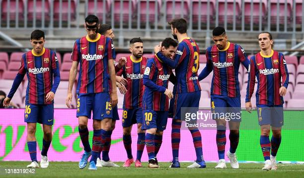 Lionel Messi of FC Barcelona celebrates after scoring their team's first goal with Gerard Pique, Jordi Alba and Ronald Araujo during the La Liga...