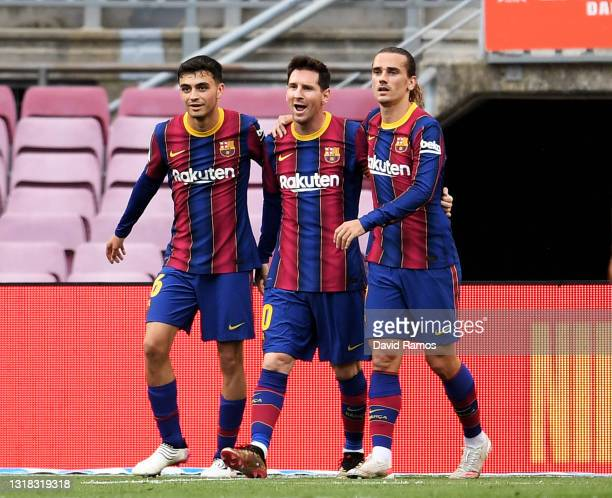Lionel Messi of FC Barcelona celebrates after scoring their team's first goal with Antoine Griezmann and Pedri during the La Liga Santander match...