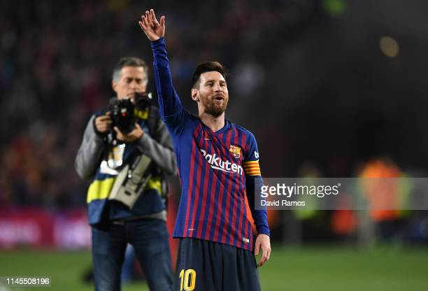 Lionel Messi of FC Barcelona celebrates as his team win the La Liga following their victory in the La Liga match between FC Barcelona and Levante UD...