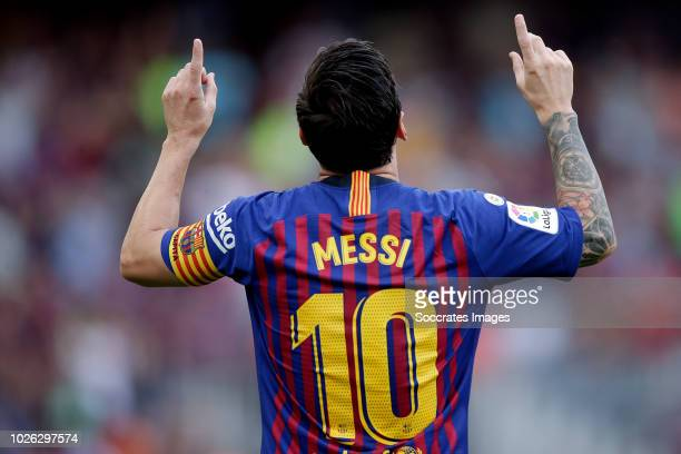 Lionel Messi of FC Barcelona celebrates during the La Liga Santander match between FC Barcelona v SD Huesca at the Camp Nou on September 2 2018 in...