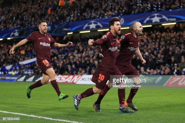 Lionel Messi of FC Barcelona celebrates his goal with Andres Iniesta and Jordi Alba during the UEFA Champions League Round of 16 First Leg match...