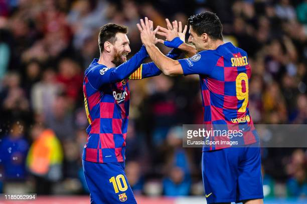 Lionel Messi of FC Barcelona celebrates his goal with Luis Suarez of FC Barcelona teammates during the UEFA Champions League group F match between FC...