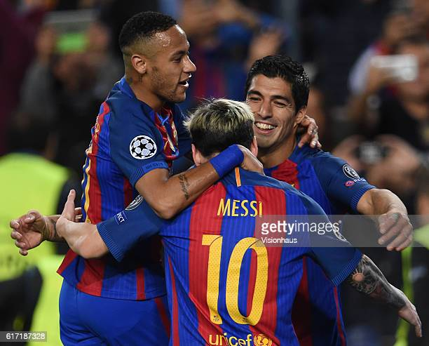 Lionel Messi of FC Barcelona celebrates his hattrick with Luis Suarez and Neymar Jr during the UEFA Champions League Group C match between FC...