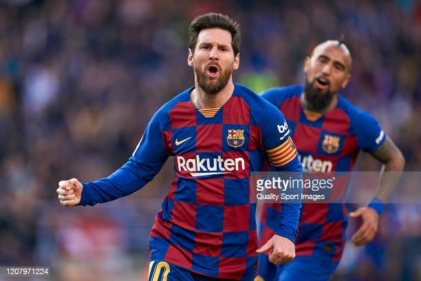Lionel Messi of FC Barcelona celebrates his team's first goal during the Liga match between FC Barcelona and SD Eibar SAD at Camp Nou on February 22...