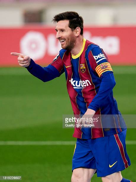 Lionel Messi of FC Barcelona celebrates his team's first goal during the La Liga Santander match between FC Barcelona and Granada CF at Camp Nou on...