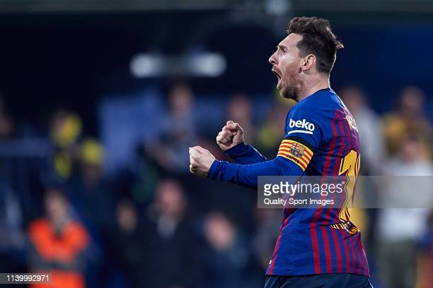 Lionel Messi of FC Barcelona celebrates his team's fourth goal scored by Luis Suarez of FC Barcelona during the La Liga match between Villarreal CF...