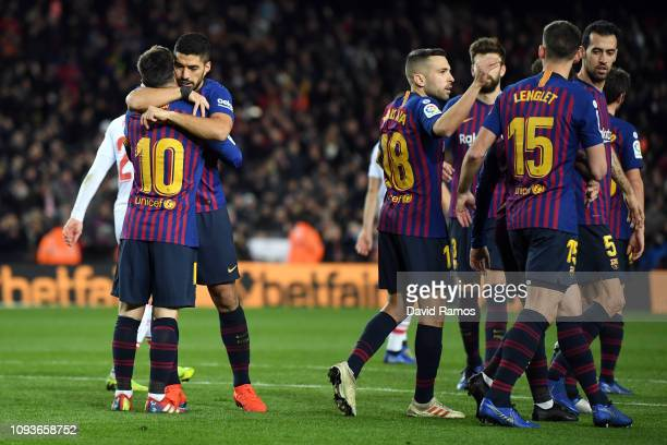 Lionel Messi of FC Barcelona celebrates his team's second goal with team mate Luis Suarez during the La Liga match between FC Barcelona and SD Eibar...