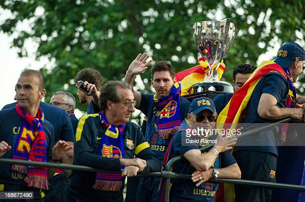 Lionel Messi of FC Barcelona celebrates on the open top bus with his teammates during celebrations after winning the Spanish Liga on May 13 2013 in...