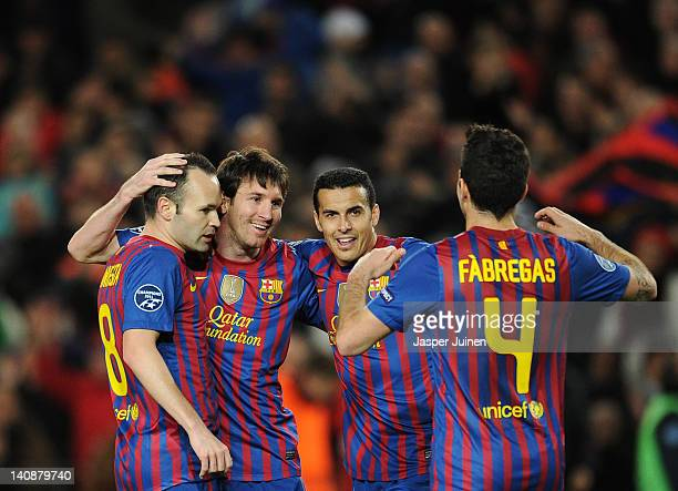 Lionel Messi of FC Barcelona celebrates scoring his sides second goal with his teammates Andres Iniesta Pedro Rodriguez and Cesc Fabregas during the...