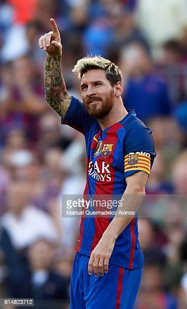 Lionel Messi of FC Barcelona celebrates scoring his team's fourth goal during the La Liga match between FC Barcelona and RC Deportivo de La Coruna at...