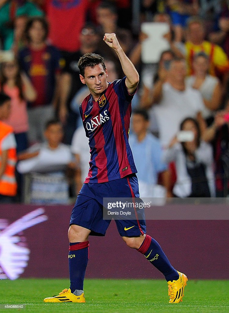 Lionel Messi of FC Barcelona celebrates scoring his team's opening goal during the La Liga match between FC Barcelona and Elche FC at Camp Nou stadium on August 24, 2014 in Barcelona, Spain.