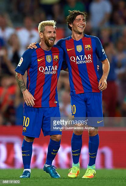 Lionel Messi of FC Barcelona celebrates scoring his team's second goal with his teammate Sergi Roberto during the Joan Gamper trophy match between FC...