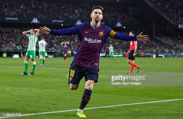 Lionel Messi of FC Barcelona celebrates scoring his team's third goal during the La Liga match between Real Betis Balompie and FC Barcelona at...