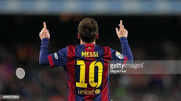 Lionel Messi of FC Barcelona celebrates scoring the first goal during the La Liga match between FC Barcelona and UD Almeria at Camp Nou on April 8...