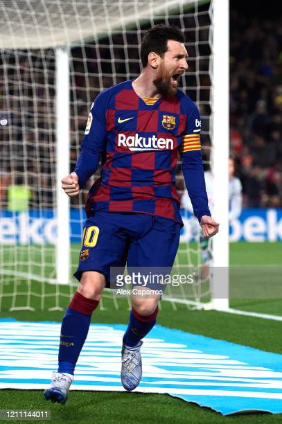 Lionel Messi of FC Barcelona celebrates scoring the opening goal during the Liga match between FC Barcelona and Real Sociedad at Camp Nou on March 07...