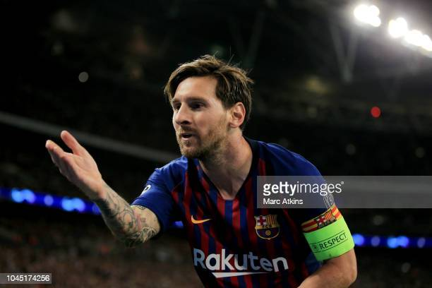 Lionel Messi of FC Barcelona celebrates scoring their 3rd goal during the Group B match of the UEFA Champions League between Tottenham Hotspur and FC...