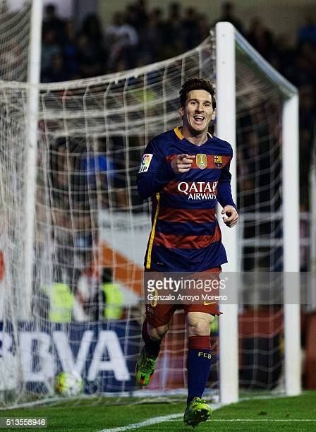 Lionel Messi of FC Barcelona celebrates scoring their second goal during the La Liga match between Rayo Vallecano de Madrid and FC Barcelona at...