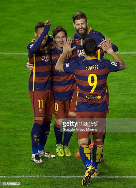 Lionel Messi of FC Barcelona celebrates scoring their third goal with teammates Neymar JR Gerard Pique and Luis Suarez during the La Liga match...