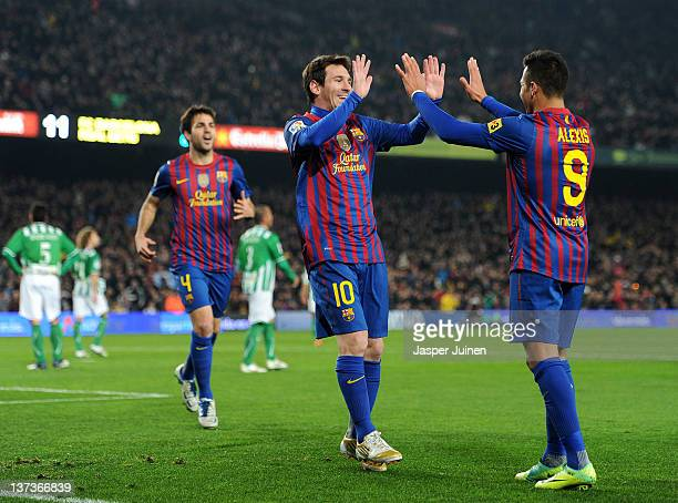 Lionel Messi of FC Barcelona celebrates scoring with his teammate Alexis Sanchez during the la Liga match between FC Barcelona and Real Betis...