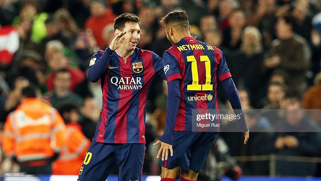 Lionel Messi of FC Barcelona celebrates the first goal with his team-mate Neymar during the La Liga match between FC Barcelona and RCD Espanyol at Camp Nou on December 7, 2014 in Barcelona, Spain.
