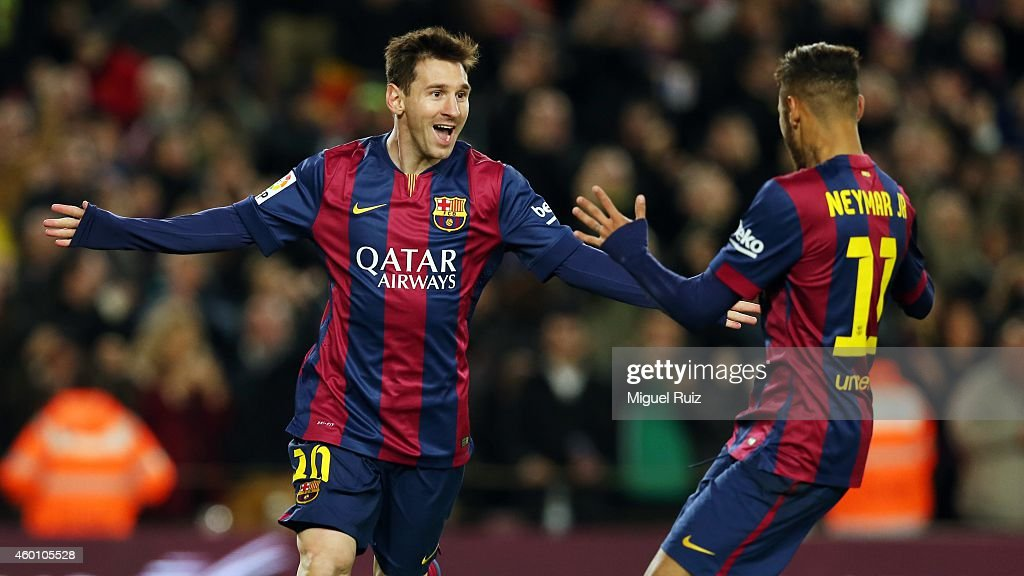 Lionel Messi of FC Barcelona celebrates the second goal with his team-mate Neymar during the La Liga match between FC Barcelona and RCD Espanyol at Camp Nou on December 7, 2014 in Barcelona, Spain.