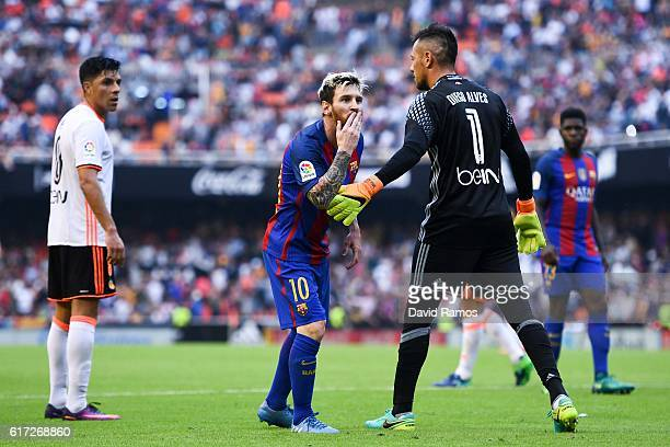 Lionel Messi of FC Barcelona celebrates towards a TV camera after scoring his team's third from the penalty spot goal during the La Liga match...