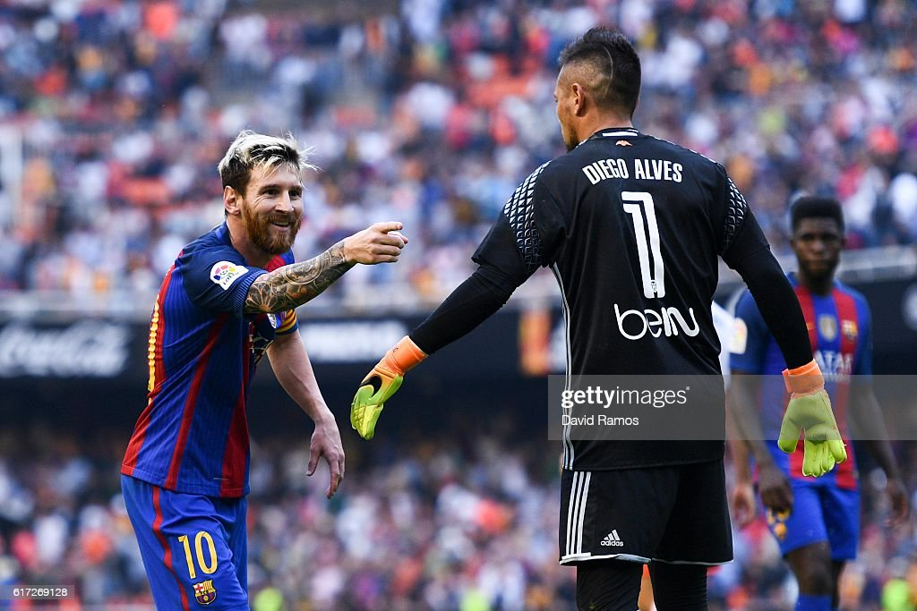 Lionel Messi of FC Barcelona celebrates towards a TV camera after scoring his team's third from the penalty spot during the La Liga match between Valencia CF and FC Barcelona at Mestalla stadium on October 22, 2016 in Valencia, Spain.
