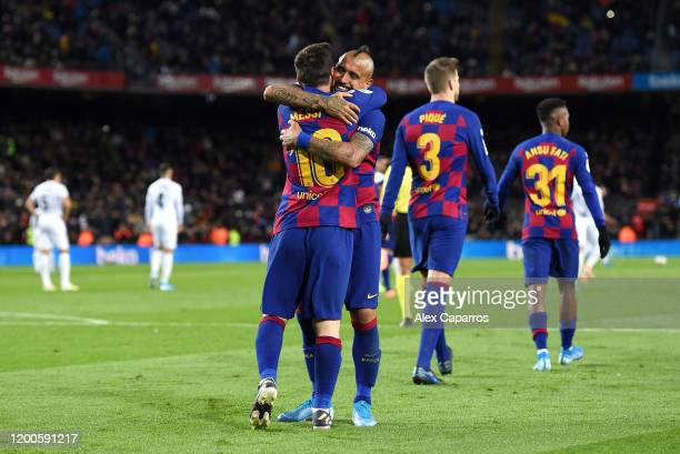 Lionel Messi of FC Barcelona celebrates with Arturo Vidal of FC Barcelona after scoring his team's first goal during the La Liga match between FC...