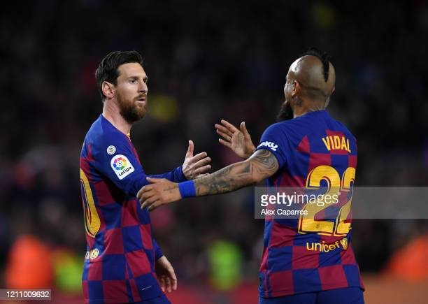 Lionel Messi of FC Barcelona celebrates with Arturo Vidal of FC Barcelona after scoring his sides first goal during the La Liga match between FC...