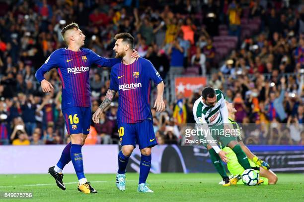 Lionel Messi of FC Barcelona celebrates with his team mate Gerard Delofeu of FC Barcelona after scoring his team's first goal from the penalty spot...