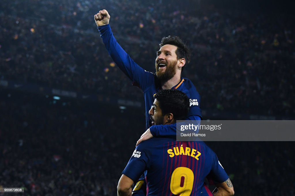 Lionel Messi of FC Barcelona celebrates with his team mate Luis Suarez after scoring his team's second goal during the La Liga match between Barcelona and Real Madrid at Camp Nou on May 6, 2018 in Barcelona, Spain.