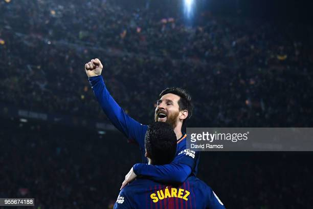 Lionel Messi of FC Barcelona celebrates with his team mate Luis Suarez after scoring his team's second goal during the La Liga match between...