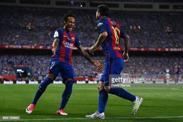 Lionel Messi of FC Barcelona celebrates with his team mate Neymar Jr after scoring his team's first goal during the Copa Del Rey Final between FC...