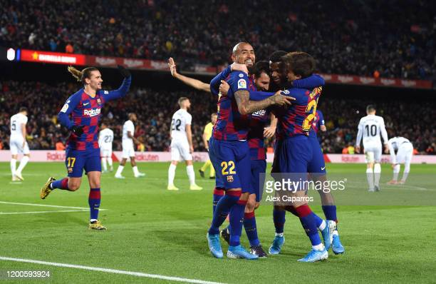 Lionel Messi of FC Barcelona celebrates with his team mates after scoring his team's first goal during the La Liga match between FC Barcelona and...