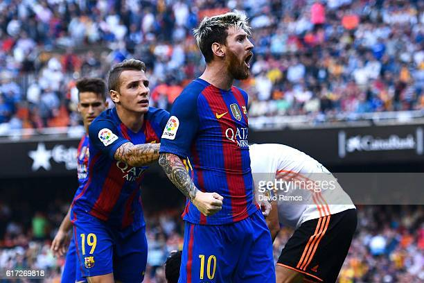 Lionel Messi of FC Barcelona celebrates with his team mates as Neymar Jr. And Luis Suarez reacts on the pitch after being hit by objects thrown from...