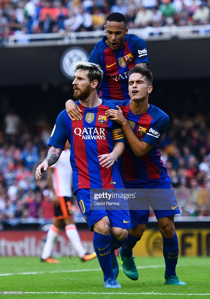 Lionel Messi of FC Barcelona celebrates with his team mates Neymar Jr. (C) and Denis Suarez after scoring his team's third from the penalty spot goal during the La Liga match between Valencia CF and FC Barcelona at Mestalla stadium on October 22, 2016 in Valencia, Spain.