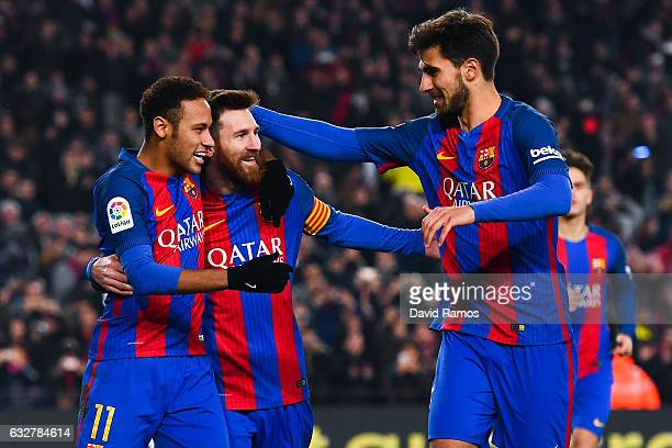 Lionel Messi of FC Barcelona celebrates with his team mates Neymar Jr and Andre Gomes after scoring from the penalty spot his team's second goal...