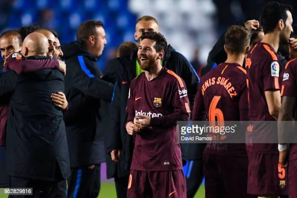 Lionel Messi of FC Barcelona celebrates with his team mates winning La Liga title after the La Liga match between Deportivo La Coruna and Barcelona...