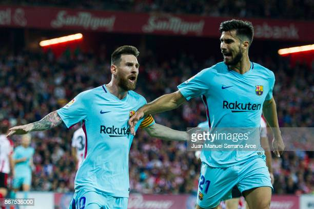 BILBAO SPAIN OCTOBER Lionel Messi of FC Barcelona celebrates with his teammate Andre Gomes of FC Barcelona after scoring the opening goal during the...