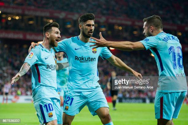 Lionel Messi of FC Barcelona celebrates with his teammate Andre Gomes and Jordi Alba of FC Barcelona after scoring the opening goal during the La...